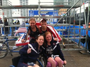 two girls in wheelchair, two girls standing. Holding American flag